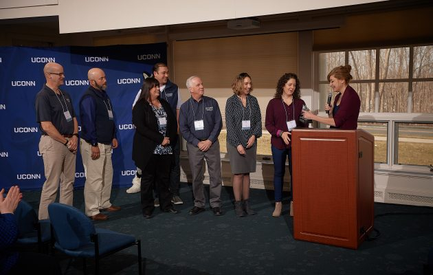 President Susan Herbst, right, presents the Team Award to Veterans Affairs and Military Programs during the UConn Spirit Awards ceremony held at Alumni Center